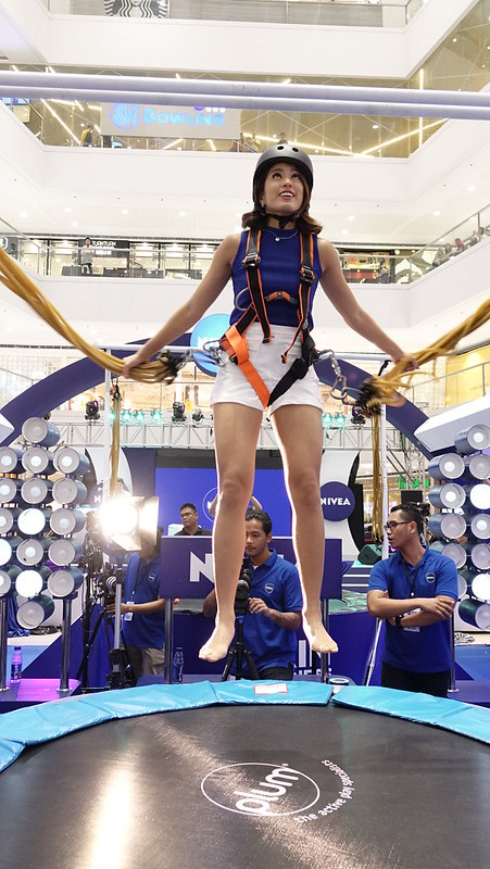 NIVEA Brand Ambassador Gretchen Ho jumping at the NIVEA Skin Firmness Check.
