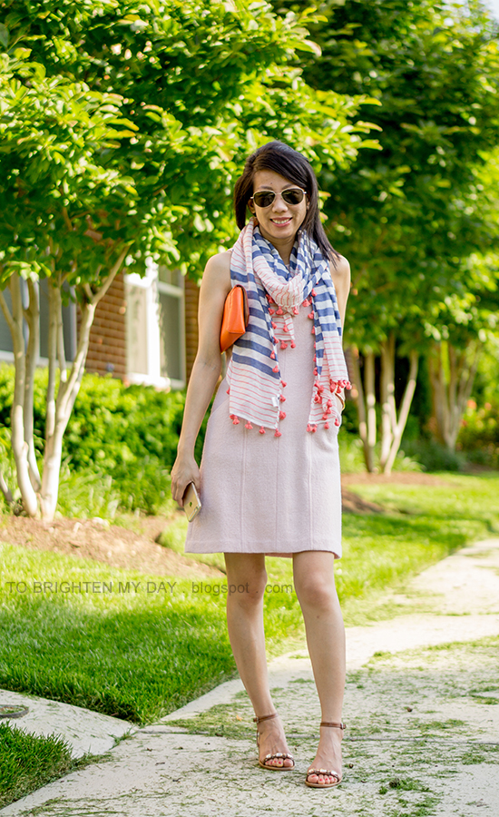 striped and pom pom scarf, pink sleeveless wool dress, orange clutch, brown jeweled sandals