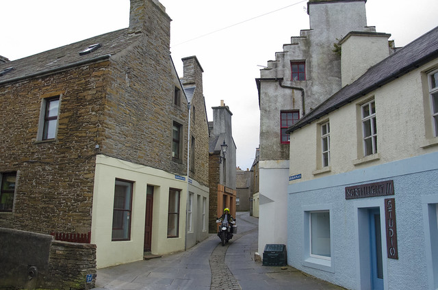R100GS PD rides through the streets of Stromness, Orkney.