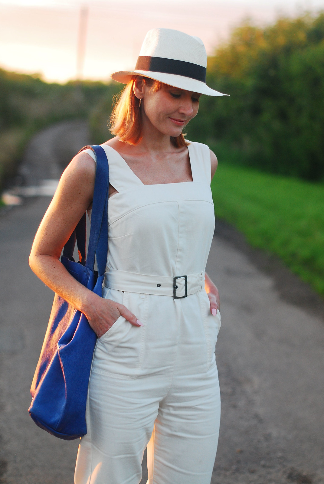Sleeveless summer overalls: Red, white and blue outfit - red wedge espadrilles, white dungarees and Panama hat, blue slouchy bag | Not Dressed As Lamb