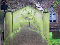 Grief grasps an urn