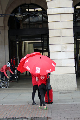 guides with umbrellas
