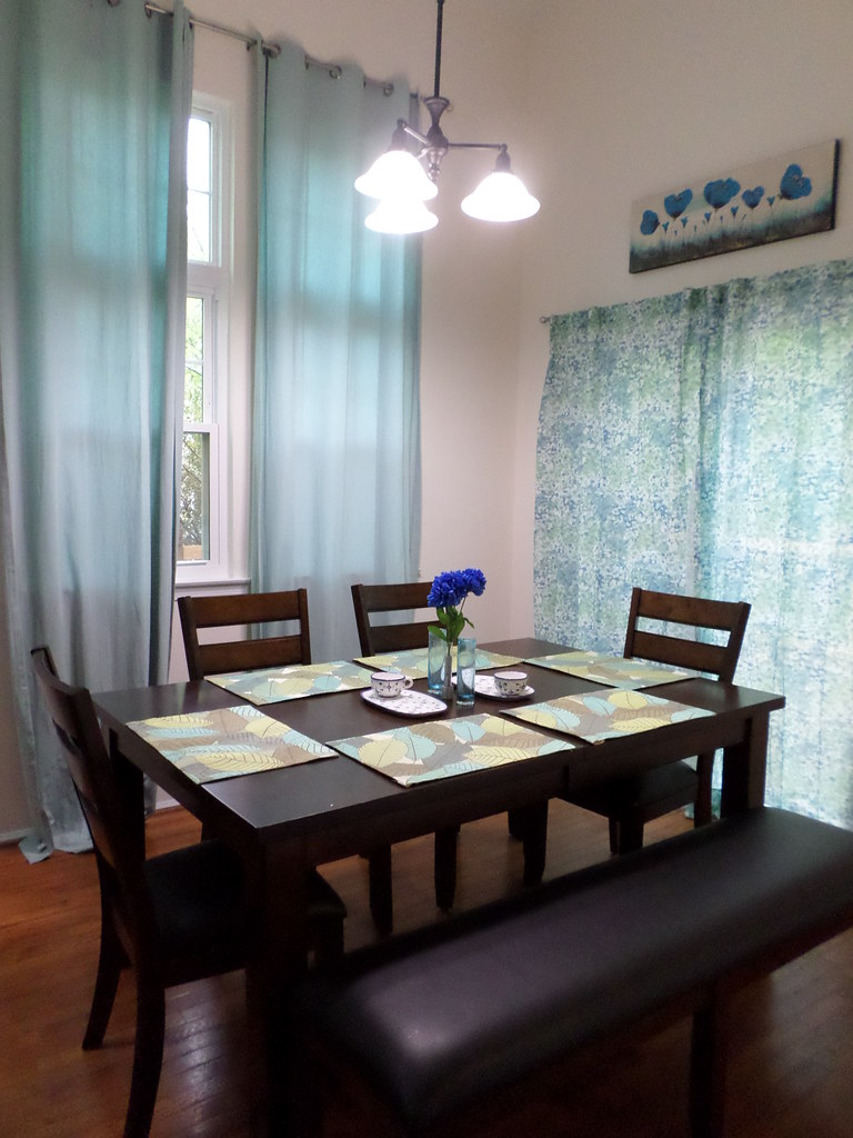 Blue, brown, and green floral theme in dining room