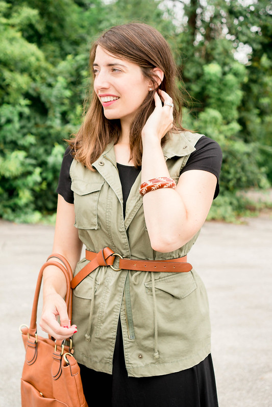 green utility vest + black flare dress + cognac knot belt + cognac Target tote + two tone sandals | Style On Target