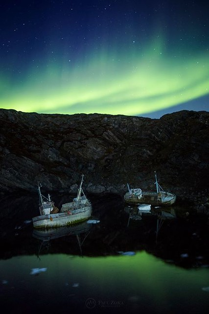 """Watery Grave"" Abandoned vessels rest in a quiet bay near Ilulissat, Greenland, as the aurora makes its nightly round. Big thanks to the team at I Love Greenland - The Travel Community of Greenland.com, to the Hotel Icefiord and to the Ilulissat Water Tax"