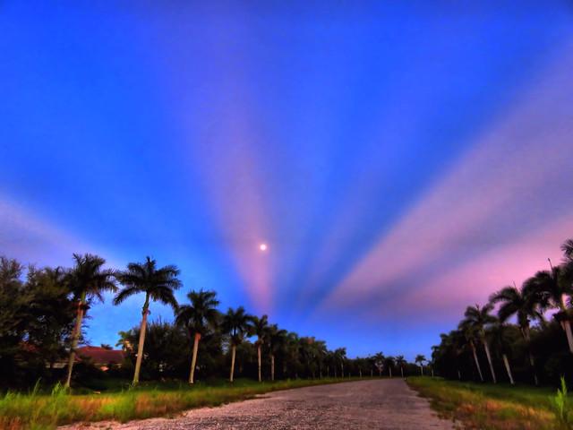 Moon setting into mirrored sunrise DPP 20160819