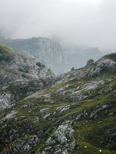 View of the mountains enveloped in fog from the mirador in the village of Bulnes in Spain