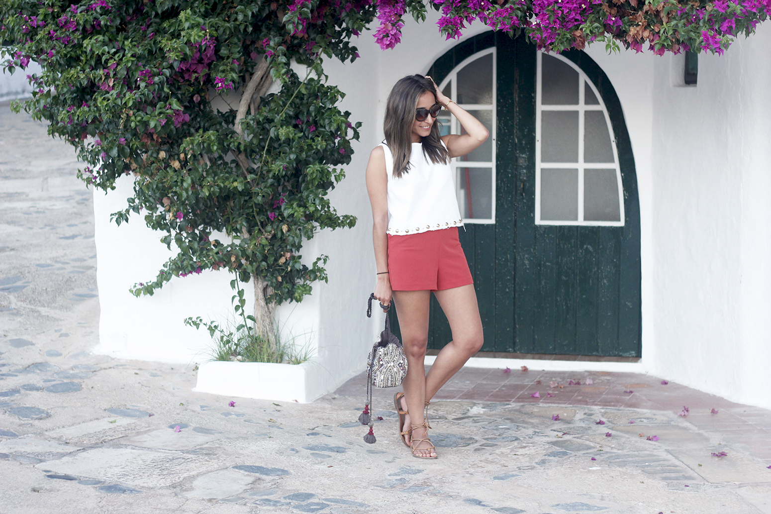 white top with shorts summer outfit flat sandals binibeca menorca10
