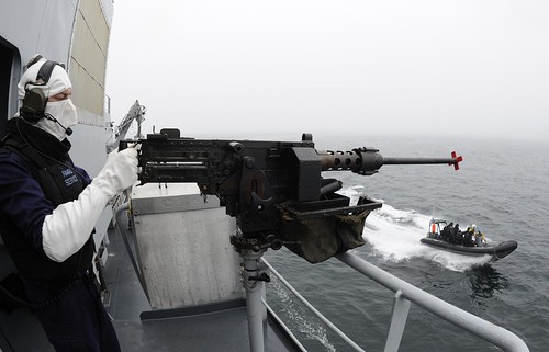 HMG Gunner with RIB in background | by Irish Defence Forces