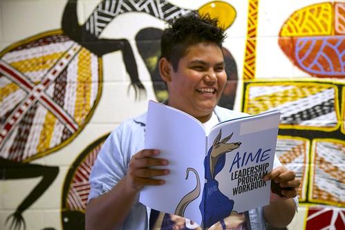 Male mentee holding leadership workbook