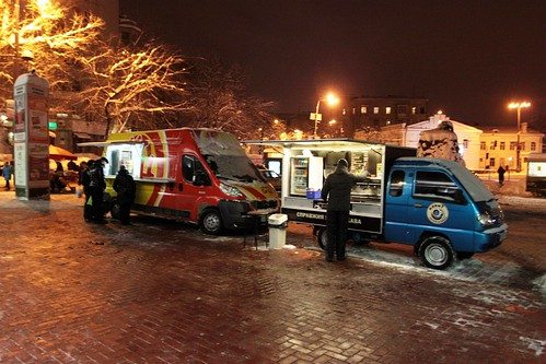 Food and coffee trucks parked outside a suburban Metro station