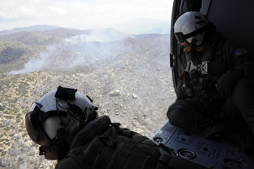 Naval Aircrewmen observe fires near San Diego. | by Official U.S. Navy Imagery