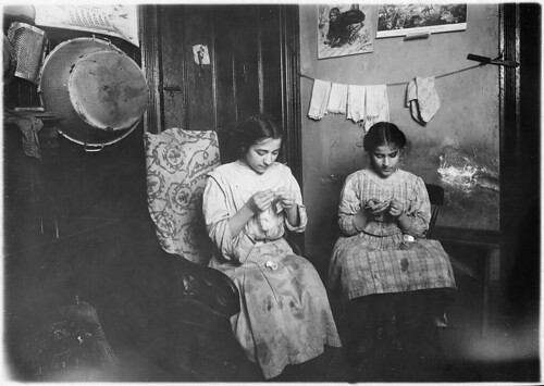 Katie, 13 years old, and Angeline, 11 years old, making cuffs, January 1912 | by The U.S. National Archives