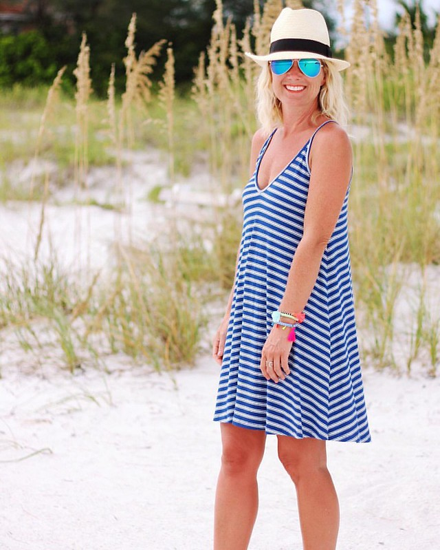 Another gorgeous beach day that ended with a spectacular storm. ☀️⛈ And now, Olympics!  // This striped rib tank dress has the cutest lace-up back & only $38! Comes in 4 great colors, too. #sugarplumstyle  #sugarplumtravels // http://liketk.it/2oZvD