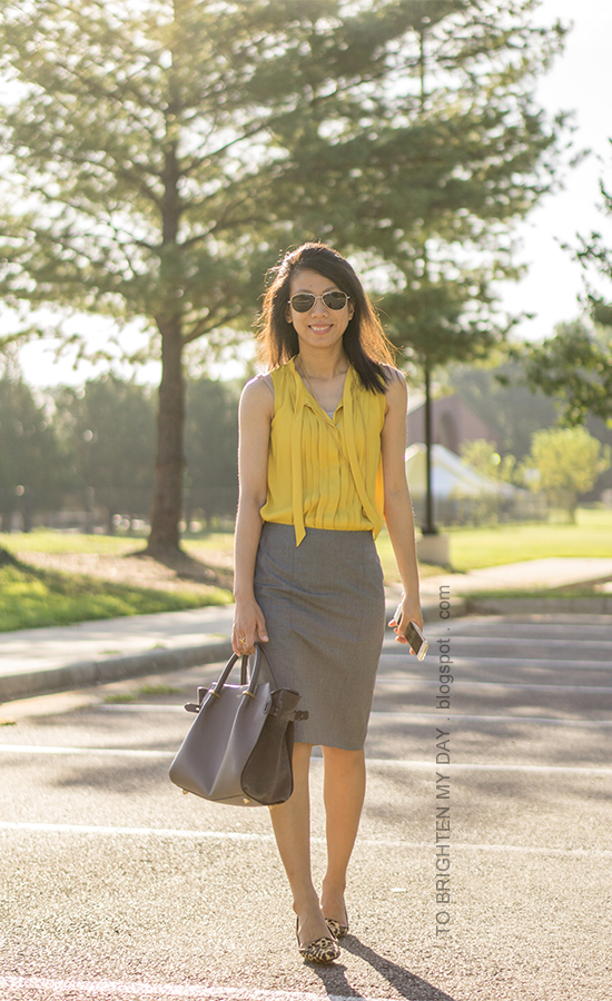 mustard yellow pleated top, gold pendant, gray pencil skirt, gray tote, leopard flats