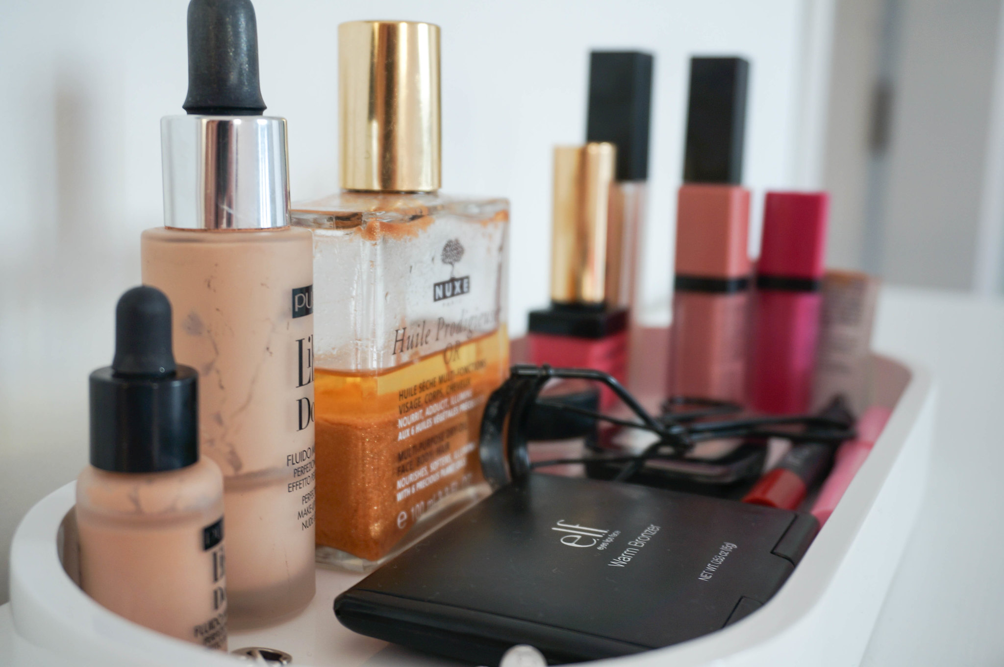 nuxe-pupa-makeup-milano-ysl-kiss-and-blush-elf-warm-bronzer-like-a-doll-fluid-foundation-nars-cruella-makeup-store-bourjois