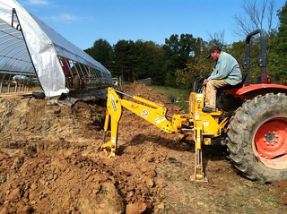 Mr. Starline digging French drains for the high tunnel | by JackieOsBrewery