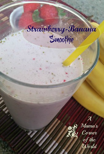 Strawberry banana smoothie in a glass with a yellow straw