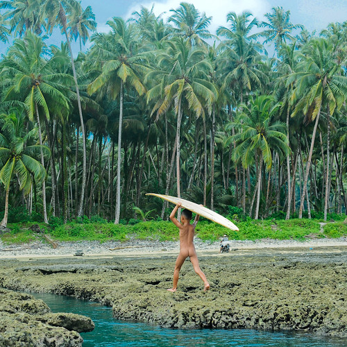 Indonesian boy with surfboard,Nias