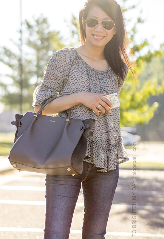 ruffled sheer top, skinny jeans, gray tote, stacked rings