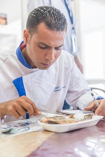 A young Egyptian chef tasting a sample as part of a tasting test, Abbassa, Sharkia, Egypt. Photo by Heba El Begawi