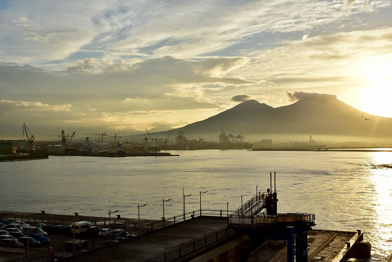 Mt. Vesuvius and Naples Harbor - cranes look like trees