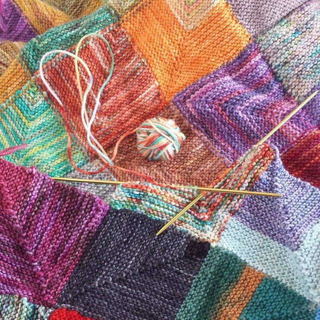 haven't knit on this blanket in a very long time! Need to get used to knitting these squares again, I might be buying a bunch of yarn tomorrow to attempt to knit a mitered square blanket in a week... it will be worsted yarn, so maybe not impossible... We'