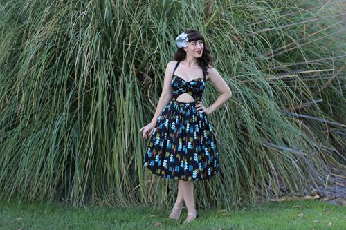 Pinup Girl Clothing Pinup Couture Renee Dress in Orange Tiki Print