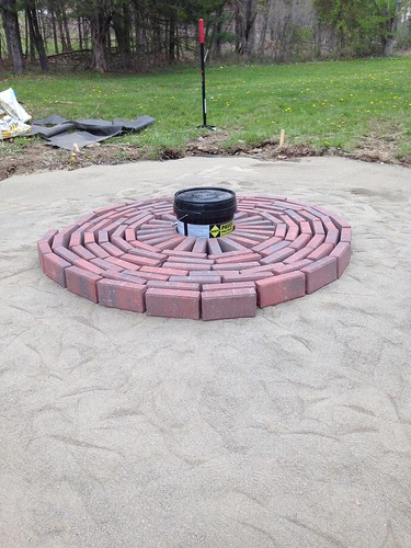 Stacked bricks on sand for firepit patio pattern