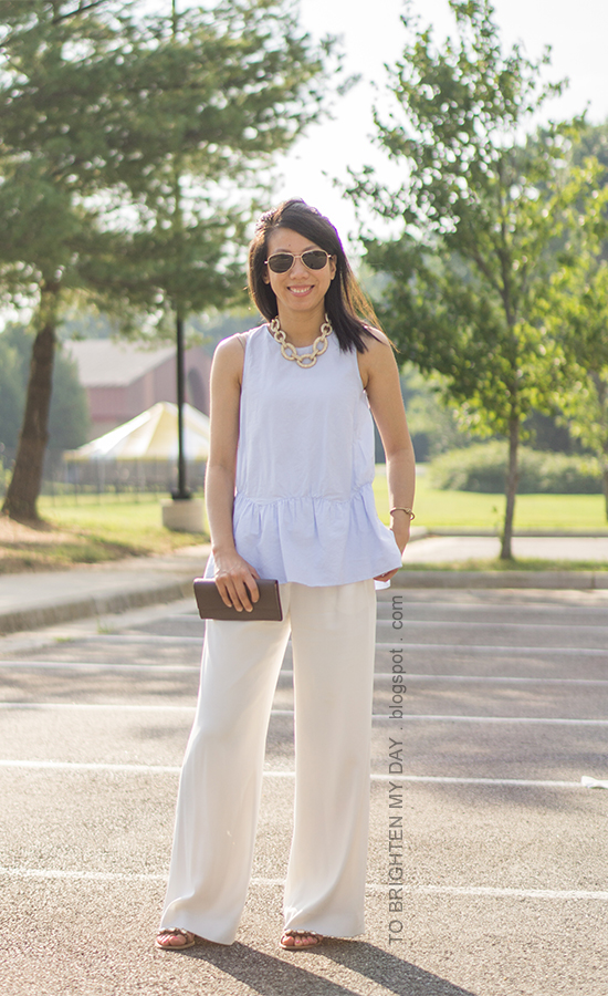 gold pave link necklace, baby blue peplum top, white wide-legged trousers, taupe clutch, jeweled sandals