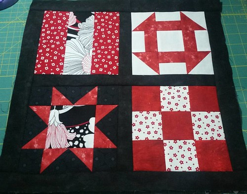 My piecing/machine quilting basics sample is taking shape, but I don't have the right fabric for the mitered border.