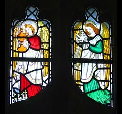 angels holding a myrrh pot and a star