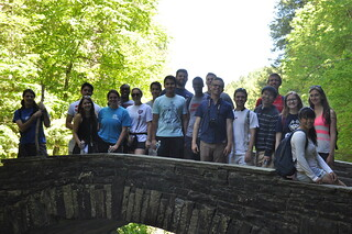 Group photo of student interns on the stone bridge at Taughannock Falls State Park.