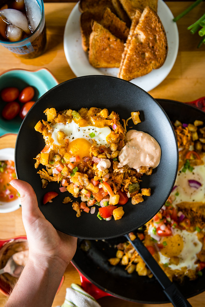 Spicy Chipotle Breakfast Hash Browns - A great way to use up leftovers and make an epic breakfast for the family! This one uses just a few russet potatoes and fresh eggs for a quick delicious meal - perfect for weekend brunching.
