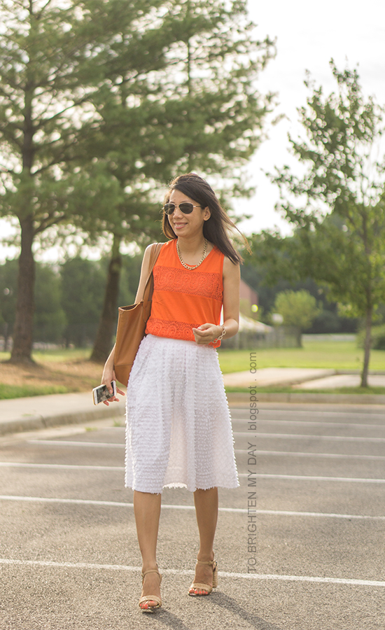 orange lace tank, gold chain necklace, white clip dot midi skirt, raffia heels, cognac brown tote