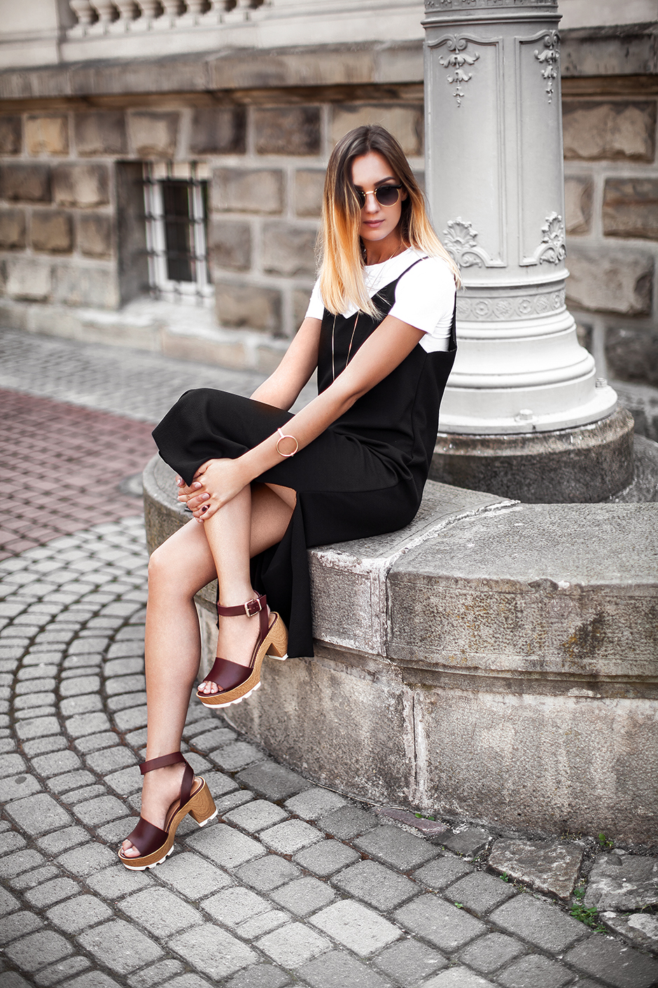 black-dress-over-white-top-outfit-street-style