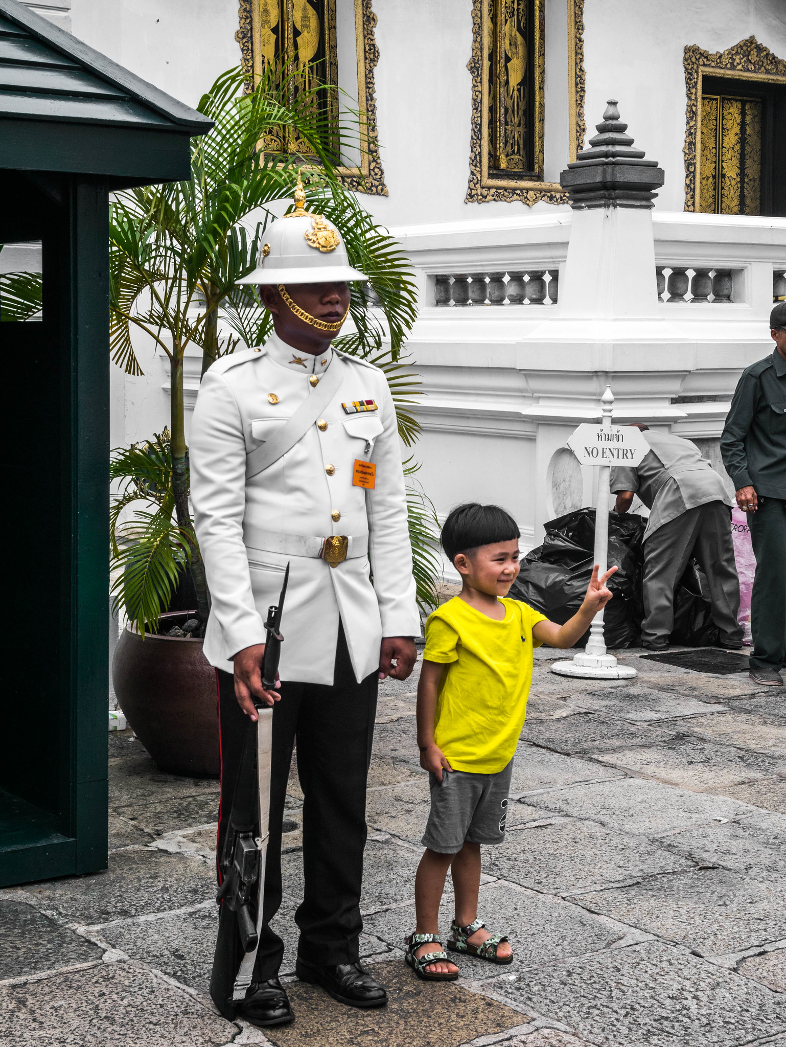 Guard at Grand Palace with a boy