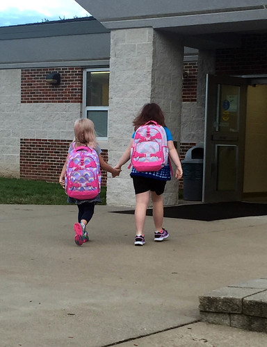 Big sister leads the way to elementary school