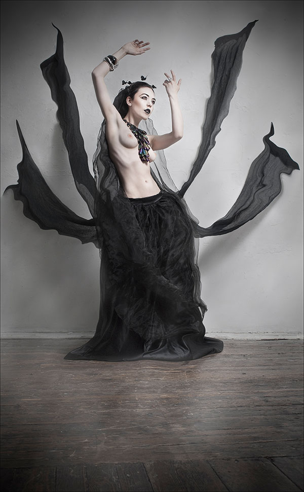 Gestalta photographed by Lorraine Gilligan. Dramatic, gothic portrait of a pale skinned girl dressed in floating black material.