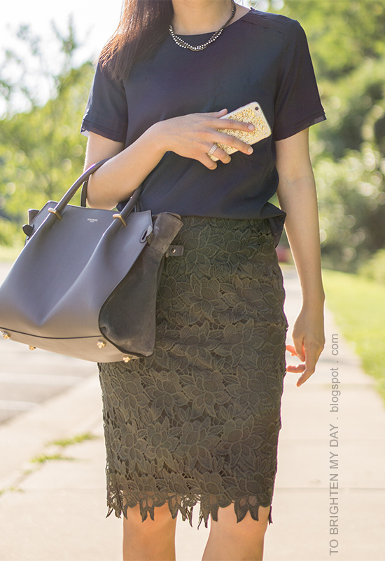 woven necklace, navy silk top, olive green lace pencil skirt, gray tote