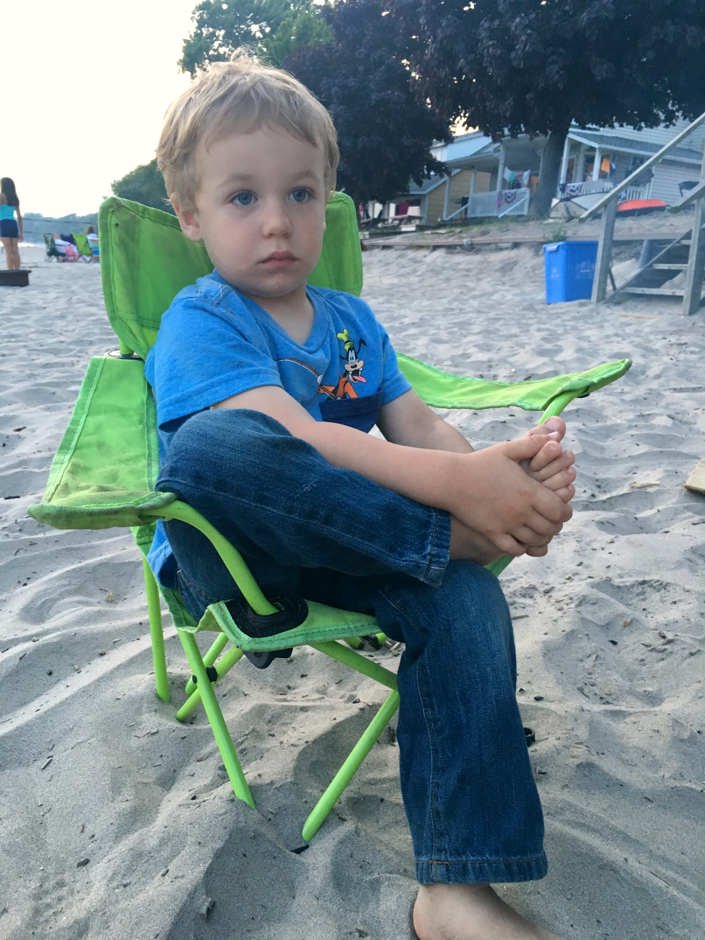 Sleepy guy at the beach fire