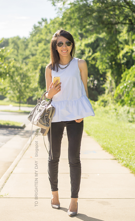 woven necklace, light blue sleeveless peplum top, black jeans, gray suede pumps, stacked rings