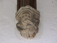 Methwold, Norfolk, St George, bagpipe player